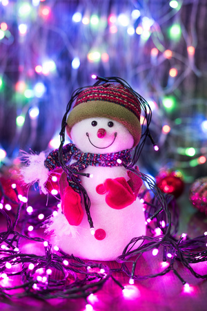 Christmas funny decorative snowmen on wooden board on lights background Christmas with copy space Stock Photo
