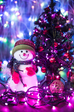 scintillating: Christmas funny decorative snowmen on wooden board on lights background Christmas with copy space Stock Photo