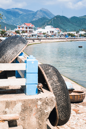 paddles: Harbor with fishing Vietnamese boats. Local fishing boats made from big baskets on pier. Traditional Vietnam boat Stock Photo