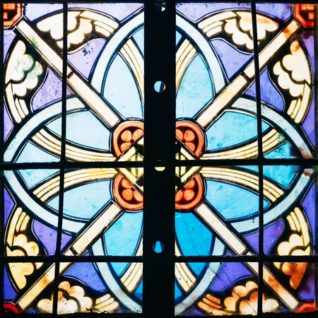 Image of a multicolored stained glass window. Stained glass in a cathedral with irregular block pattern Stock Photo