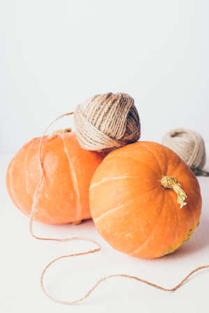 Studio shot of orange pumpkins on wooden table. Copy space for the text