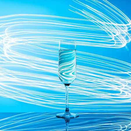 Alcoholic cocktail, blue glow. Nightclub party concept Stock Photo