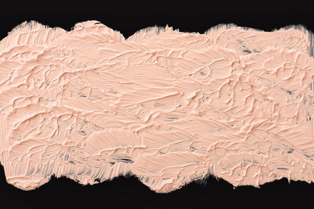Close up of a make up liquid cream foundation on black background