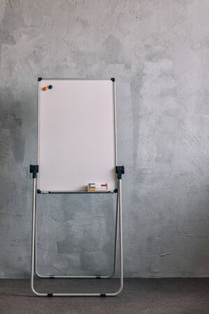 Big white board markers on grey Stock Photo