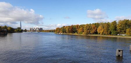Saint-Petersburg, Russia. October Autumn park and river, panoramic view. Mobile photography