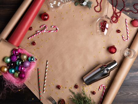 Christmas background, wrapping paper on wooden table. Bar tools, top view 写真素材
