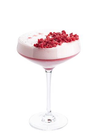 Clover Club alcoholic cocktail in champagne saucer glass isolated on white background. Beverage garnished with red dried raspberry