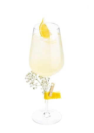 White wine spritzer alcoholic cocktail in champagne saucer glass isolated on white background Stock fotó