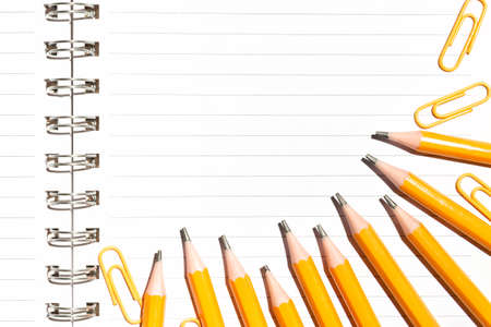 Notebook and yellow pencils. Minimal school or office supplies concept. Flat lay, top view, copy space for text Stock fotó