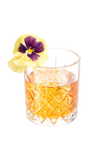 Boozy cherry old fashioned alcoholic cocktail with whiskey and ice cube in a glass isolated on white background.