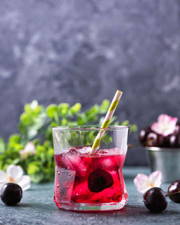 Cold sweet cherry non alcohol drink with ice