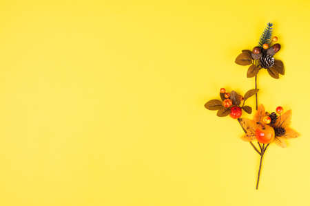 Autumn composition with fall leaves on ultimate yellow backgroun