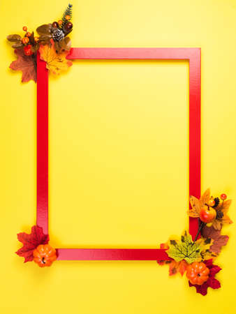 Autumn composition with red frame and fall leaves Standard-Bild