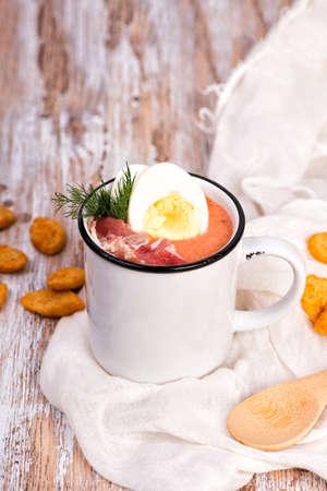 Spanish salmorejo cream soup with ham and egg Standard-Bild