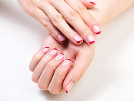 Female hands with a trendy autumn french manicure