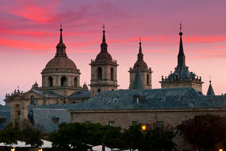 San Lorenzo de El Escorial Monastery  with beautiful sky right after sunset. Four towers are set off by sky with pink and purple hues. Stock Photo - 12017813