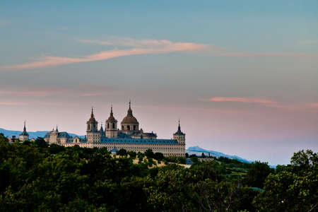 lorenzo: San Lorenzo de El Escorial Monastery from a distance with beautiful sky right after sunset.