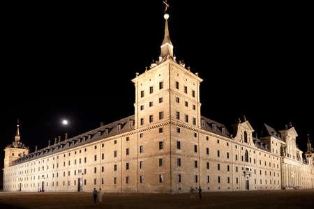 lorenzo: San Lorenzo de El Escorial Monastery  at night beautifully illuminated. Four towers are set off by black background. Editorial