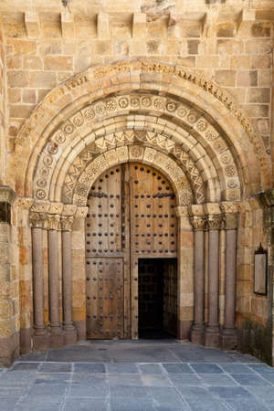 Architectural detail of an old church door in Avila, Spain with beautiful beige stone detail, arches and columns. 스톡 사진