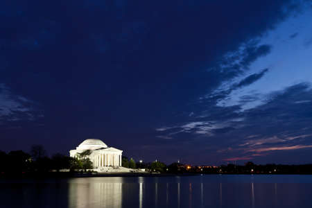 Thomas Jefferson Memorial with reflecting in the Tidal Basin in Washington DC at dusk shortly after sunset with dramatic skies Editorial