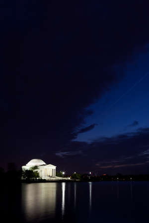 verticals: Thomas Jefferson Memorial with reflecting in the Tidal Basin in Washington DC at dusk with dramatic sky