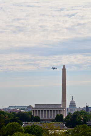 April 17, 2012 - Washington, DC, U S  Space shuttle Discovery, mounted on the Shuttle Carrier Aircraft, has flown over the Washington Monument, Capitol and Lincoln Memorial in the Washington, D C  area Editorial
