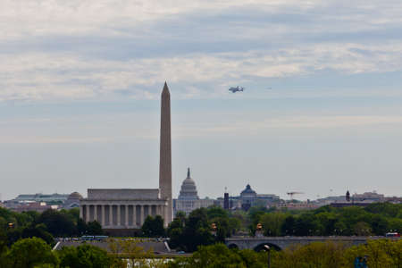 April 17, 2012 - Washington, DC, U S  Space shuttle Discovery, mounted on the Shuttle Carrier Aircraft, has flown over the Washington Monument, Capitol and Lincoln Memorial in the Washington, D C  area