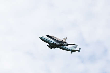 April 17, 2012 - Washington, DC, U S  Space shuttle Discovery, mounted on the Shuttle Carrier Aircraft, has flown over the Washington, D C  area