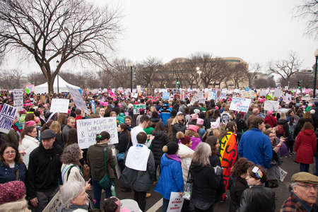 Crowds gathered on the National Mall to protest President Trumps positions on womens and other human rights.
