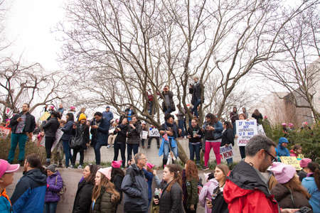 Crowds climbed higher to take in the atmosphere during the peaceful rally protesting President Trumps positions on womens and other human rights.