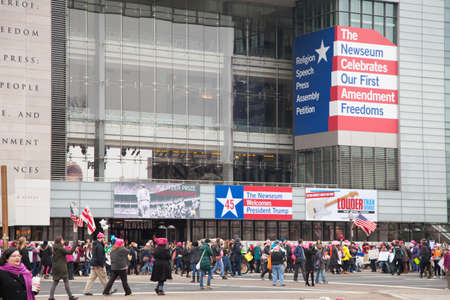 The Newseum with the 1st Amendment to the Constitution edged on its facade along with inaugural sign welcoming President Trump contrasts with crowds gathering to protest President Trumps positions on womens and other human rights on womens and other hu Editorial