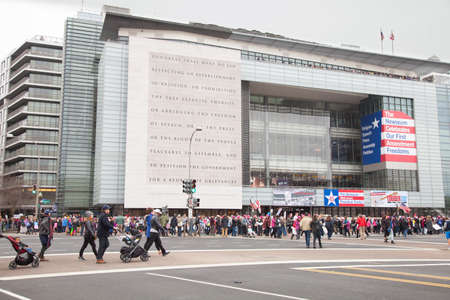 The Newseum with the 1st Amendment to the Constitution edged on its facade serves as a backdrop to crowds gathering to protest President Trumps positions on womens and other human rights.