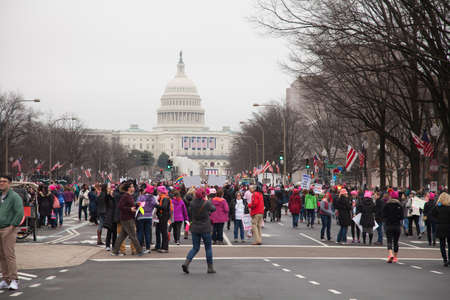 Women gather on Pennsylvania Avenue, NW, with the United States Capitol in the background to protest President Trumps positions on womens and other human rights. Editorial