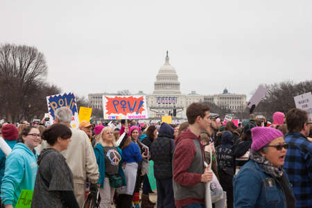 Crowds with United States Capitol building in the background gathered on the National Mall to protest President Trumps positions on womens and other human rights. Editorial