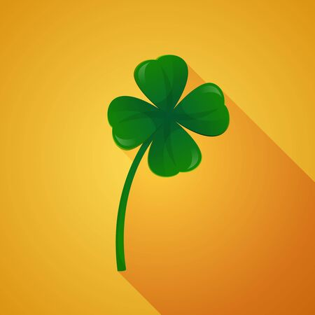 Clover with four leaves on golden background.