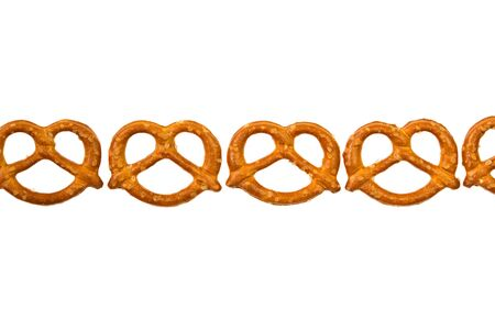 Pretzels in a row isolated on white background Stock Photo
