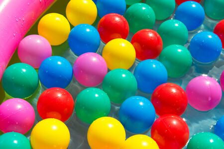 Colorful balls in the swimming pool, summer concept