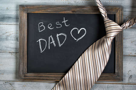 Fathers day concept, Best Dad written on chalkboard with striped tie on wooden background 版權商用圖片