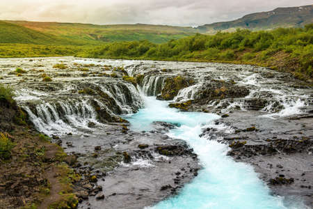 Bruarfoss waterfall with turquoise water cascades at sunset, Iceland Reklamní fotografie