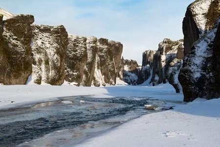 Fjadrargljufur frozen canyon at winter, Iceland 스톡 콘텐츠