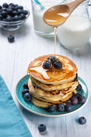 Stack of pancakes with fresh blueberry and honey, healthy breakfast concept Reklamní fotografie