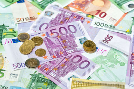 Pile of Euro banknotes and coins, money background, banking and finance concept