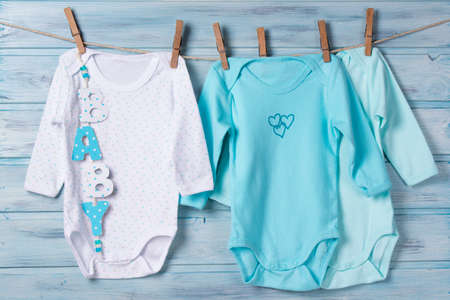 Baby clothes and word baby on a clothesline