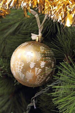 golden ball: the Golden ball on the Christmas tree Stock Photo