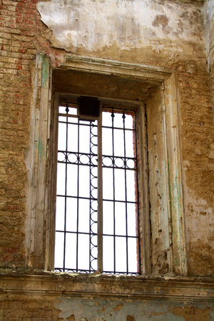 ancient prison: Old window with rusty bars Stock Photo