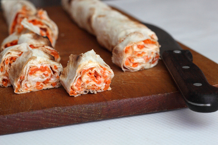 carrot tree: roll of pitta bread, carrot, eggs lie on white background