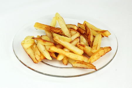 subtlety: fried potatoes on a glass plate white background