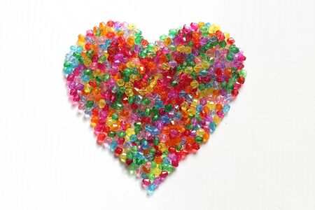 colorful beads: Colorful beads heart shape on white background