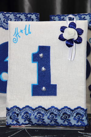 identifying: Image of a blue and white handmade number identifying banquet table