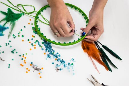 set for making a Dreamcatcher, beads, thread on a white background